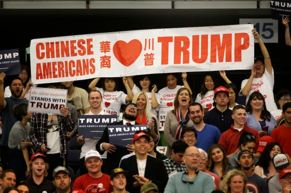 A group of Chinese people hold a banner to show their support for Republican presidential candidate Donald Trump during a rally at the Anaheim Convention Center, Wednesday, May 25, 2016, in Anaheim, Calif. (AP Photo/Jae C. Hong)